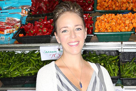 Photo of Laura MckLively in front of produce at the Berkeley Bowl