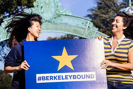 Students holding sign with BerkeleyBound in front of Sather Gate
