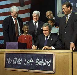 President Bush signing the No Child Left Behind law.