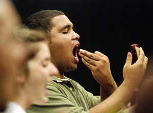 A member practicing vocal exercises
