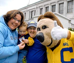 Oski and a family on Cal Day
