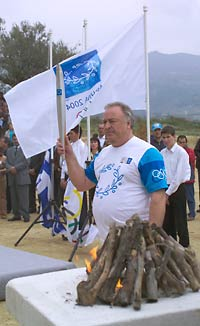 Valery Borzov with the Olympic torch in Nemea