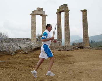 Olympig torch passes the Temple of Nemean Zeus