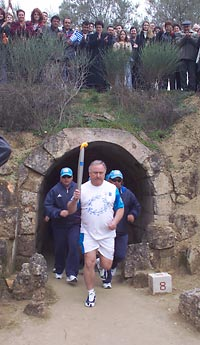 Olympic torch carried out of entrance tunnel