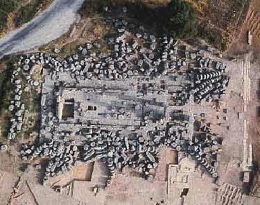 Aerial view of the Temple of Zeus in Ancient Nemea, built in 330 B.C. The column drums, averaging 2.5 tons each, can be seen scattered around the temple. UC Berkeley researchers are leading the effort to reconstruct the temple's columns. Photo courtesy of Nemea Excavations Archive, UC Berkeley