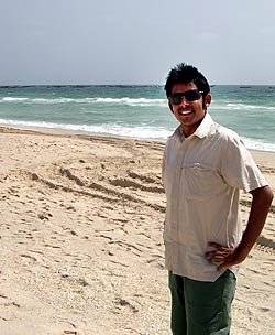 Jigar Mehta on a beach