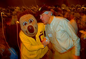 Oski and alum at party