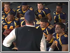 Coach Tedford and players in Pep Talk