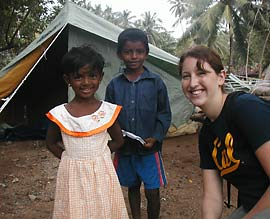 Ann Marie Edwards poses with refugee children