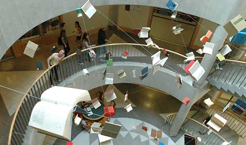Books appear to fly in the library atrium