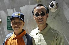 John Woo (right), with son Brian