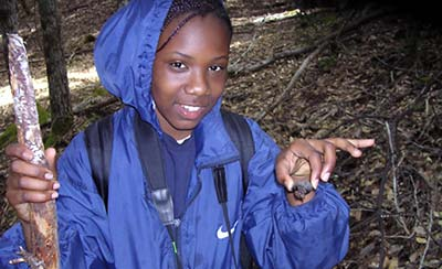 Faith, 13, holds a terrestrial snail she found in the leaf litter during a hike at Angelo Coast Range Reserve.