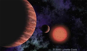 Three planets orbit the star Gliese 876 in this artist's rendering. The smallest of the trio, barely visible to the right of the small red star, is the most Earth-like extrasolar planet yet discovered.