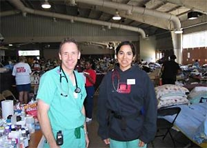 Dr. Ahmeen Ahmed with fellow doctor in evacuation shelter