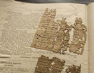 Fragments of papyrus wrapped in pages from the Oxford University Gazette