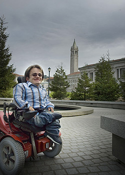 Bryan Goodwin in his wheelchair beside the reflecting pool at Memorial Glade
