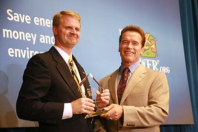 Nathan Brostrom accepts the campus's Flex Your Power Award from Gov. Schwarzenegger