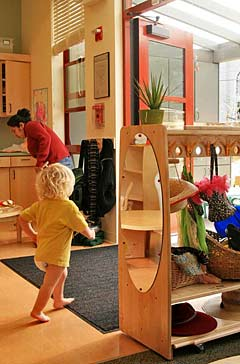 Child toddling through the new center