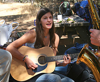 Nicole Campbell playing guitar