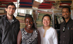 Berkeley grad students Simon Morfitt (sociology), Melissa Ho, and Admas Zedwie (business) with a health-information officer at a hospital in Rakai district, Uganda.