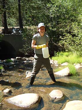 former grad student Helen Poynton collects water samples