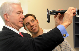 Bioengineering grad student David Breslauer demonstrates the CellScope, a device to aid in the diagnosis of disease in remote areas, to former Governor Gray Davis