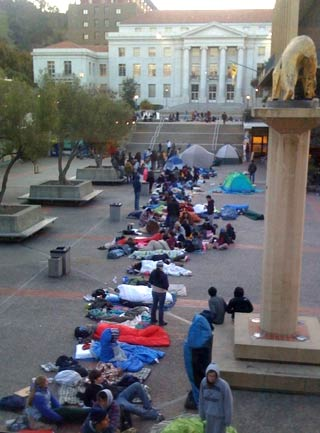 Students in sleeping bags and tents line up for Dalai Lama tickets