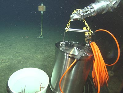 broadband seismometer being lowered to the ocean bottom