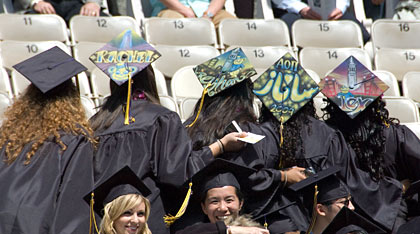 Graduates with individually decorated caps
