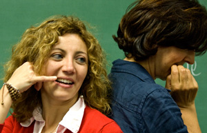 Italian scholars Maria Longobardi and Elisa Pintus practice a telephone conversation in English.