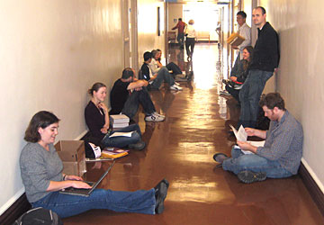 PhD students wait to turn in their printed dissertations