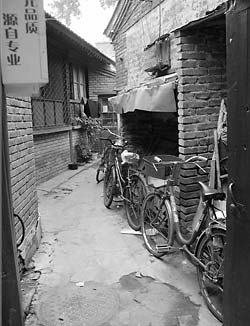 Bikes line a narrow Beijing alley