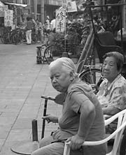 Grannies watch tourists