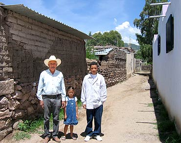 Three people on a dirt road in Jomulquillo, Mexico