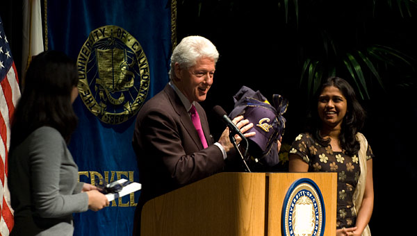 Bill Clinton at podium following his talk.