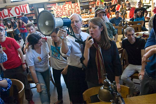 In the Doe North Reading Room, University Librarian Tom Leonard holds the megaphone as Beth Dupuis, library director, asks those present to act respectfully.