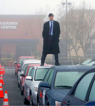 Alexandre Bayen stands atop a car