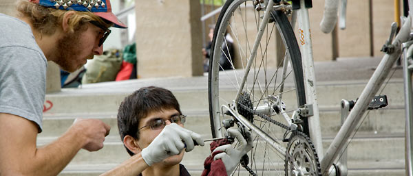 Students repairing bike