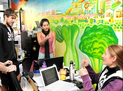 Students by vegetable mural