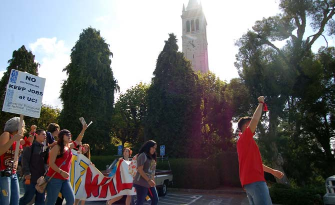 Protesters march past the Campanile