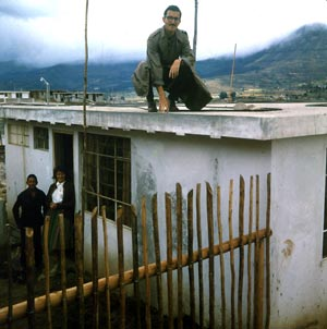 Peace Corps volunteer on house he built