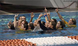 Women's team celebrates their victory with a dip in the pool