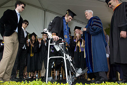 Paraplegic student stands tall and walks at commencement