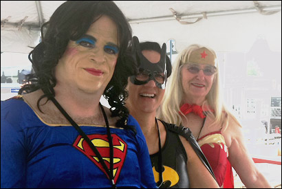 Rest stop workers in superhero drag.