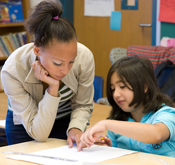 Student tutoring an elementary school child.