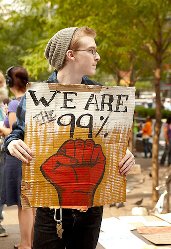 "Young protestor with sign: ""We are the 99%"""