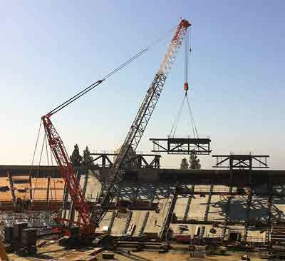 The third of the press box's three sections is lowered into place on Sunday, Oct. 9.