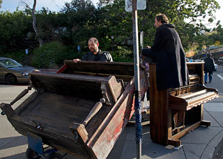 Pianos removed from Sproul Plaza wait to be trucked away