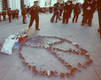 Peace sign made from spent tear-gas cannisters
