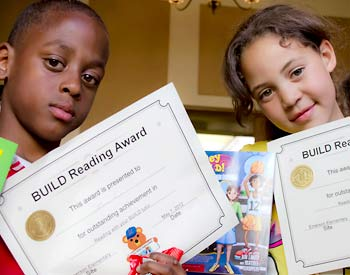 Young students with their BUILD reading awards